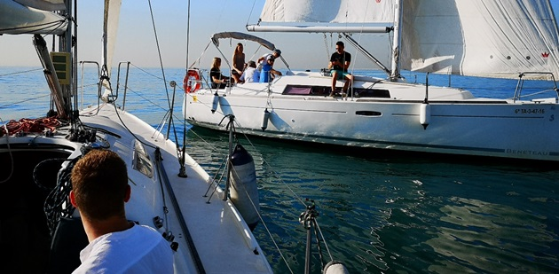 Sailing regattas are best team building events in Barcelona. Two sail boats on photo racing during a team building event.